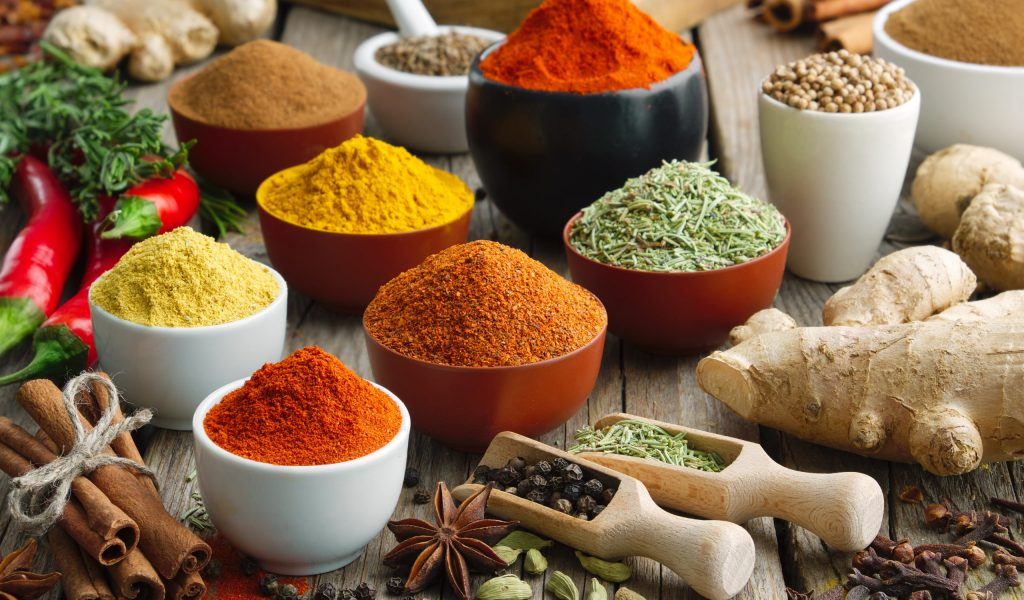Various aromatic colorful spices and herbs. Ingredients for cooking. Ayurveda treatments.